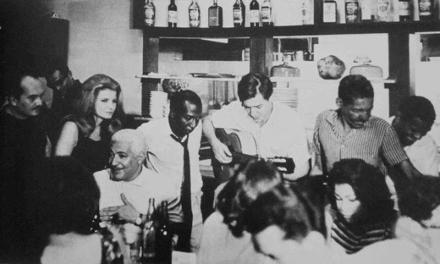 L-R: Billy Blanco, Odete, Dorival Caymmi (seated), Zé Kéti, Tom Jobim, and Cartola. Zé Kéti was largely responsible for bringing together the worlds of bossa nova and samba do morro in Rio in the early 1960s