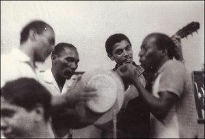 Standing, L-R: Anescarzinho do Salgueiro, Jair do Cavaquinho, Paulinho da Viola and Zé Kéti at Zicartola.
