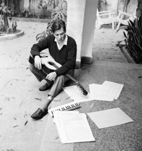 Tom composing at his home on Rua Barão da Torre in Ipanema, in the 1960s.