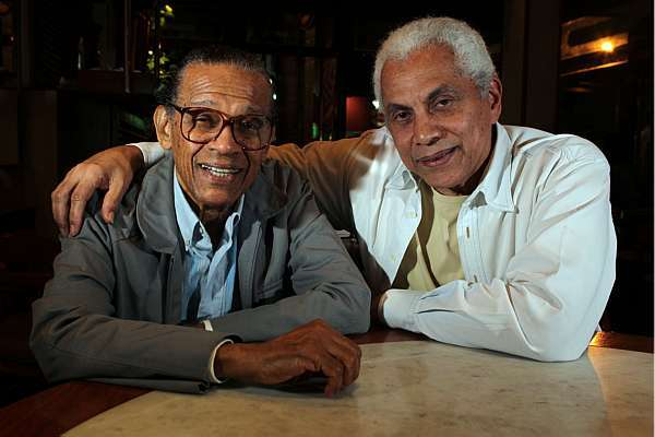 """Elton Medeiros with friend and partner Paulinho da Viola. Medeiros was a master of the matchbox but said he didn't like posing with the """"instrument"""" because he thought those kinds of pictures contributed to the folklorization of samba."""