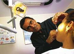 Guinga c. 2001 at his dental practice.